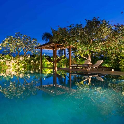 Villa Kavya Bali - Pool and Garden at Night - Canggu, Bali