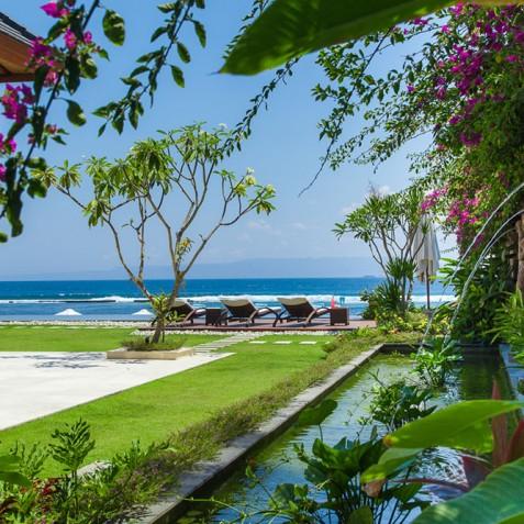 Tirta Nila Beach House, Candidasa, Bali - Garden Pond and Statues