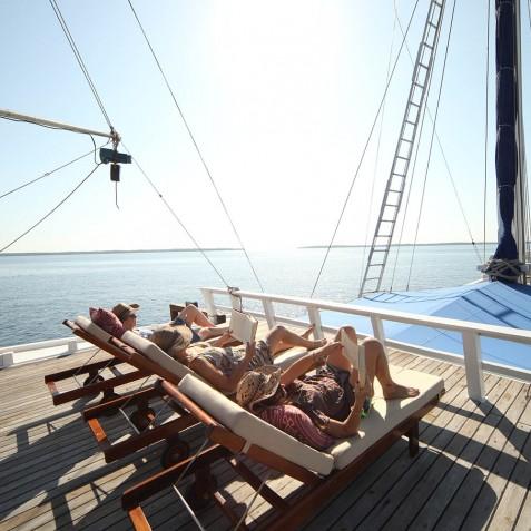Sunbathing - Ombak Putih Cruises - Sailing Adventures - Indonesia
